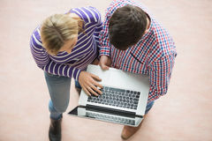 College students working on laptop Royalty Free Stock Image