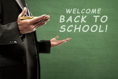 College teacher with back to school message. On the chalkboard stock photos