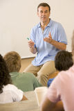 College teacher giving a lecture Royalty Free Stock Photos
