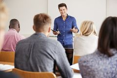 College Tutor With Digital Tablet Teaches Mature Students Royalty Free Stock Photography