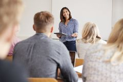 College Tutor With Digital Tablet Teaches Mature Students Stock Image