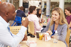 College Tutors Eating Lunch Together Stock Photography