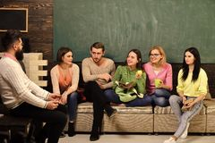 College and university concept. Group of students, group mates listening teacher, lecturer, professor. Students. Scientists studying , professor holds laptop royalty free stock photography