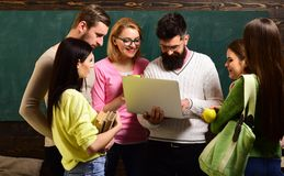 College and university concept. Group of students, groupmates spend time with teacher, lecturer, professor. Students. Scientists studying after classes stock image