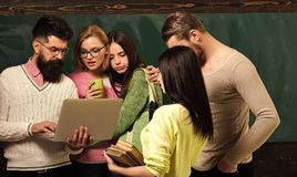 College and university concept. Group of students, groupmates spend time with teacher, lecturer, professor. Students. Scientists studying after classes royalty free stock image