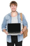 College / university student showing laptop screen. Male college / university student showing laptop screen smiling happy. Young caucasian man holding notebook Stock Images