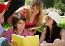 College or university students studying. Outdoors Stock Photo