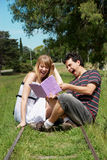 College or university students studying outdoors. Im park Stock Photo