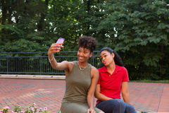Colleges student. A college student taking a selfie with a cell phone Royalty Free Stock Image