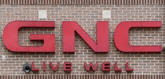 GNC,  a health-and-wellness retailer`s sign stock photography