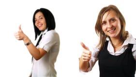 Colleghi che danno i pollici in su Fotografia Stock