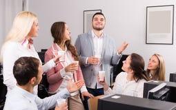 Colleghi del gruppo che bevono champagne Fotografia Stock Libera da Diritti