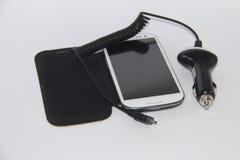Colleghi il vostro cellulare all'automobile Immagine Stock Libera da Diritti