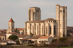 The collegiale of La Romieu, in Gascony. La Romieu is a little village in Gascony, in the southwest of France. Built between 1313 and 1318, the collegiale stock photography