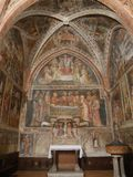 Collegiata church of St Mary in Castell`Arquato. The interior has sculpted capitals, sculptures, baptismal pieve and frescoes stock photos