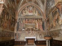 Collegiata church of St Mary in Castell`Arquato. The interior has sculpted capitals, sculptures, baptismal pieve and frescoes royalty free stock photo