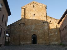 Collegiata church of St Mary in Castell`Arquato. It was rebuilt after a earthquake an it is charaterized by a romanesque `Paradise Portico` on the left side royalty free stock images