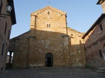 Collegiata church of St Mary in Castell`Arquato. It was rebuilt after a earthquake an it is charaterized by a romanesque `Paradise Portico` on the left side royalty free stock image