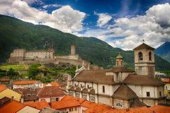 Collegiate Church and Castelgrande castle in Bellinzona, Ticino, Switzerland. Scenic view of Collegiate Church and Castelgrande castle with green mountains and Stock Photography