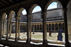 Collegiate Church and Cloisters, Saint Emilion, France. Interior courtyard of the Collegiate Church in Saint Emilion with double arched columns Royalty Free Stock Photos