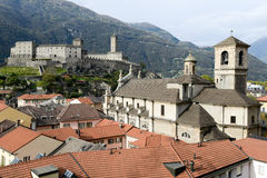 The Collegiate Church and fort Castelgrande at Bellinzona on the Royalty Free Stock Images