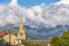 Collegiate Church of Saint-Andre in Grenoble, France. Tower of Collegiate Church of Saint-Andre in Grenoble city, France. Sunset view. French Alps on the Stock Photos