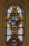 Collegiate church of Saint-Denis of Liege. LIEGE, BELGIUM-OCTOBER 19, 2014: Stained glass window in Collegiate church of Saint-Denis of Liege. The church was Royalty Free Stock Image