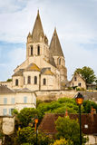 Collegiate Church of St. Ours. Street Scene in Loches, France, with Collegiate Church of Saint Ours in Background Royalty Free Stock Photo