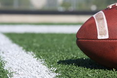 Collegiate football on the field Royalty Free Stock Photo