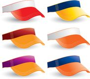 Collegiate visors. Six visors with college colors Stock Photos