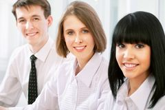 Collegues. Young business women and her team Royalty Free Stock Images