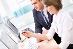 Collegues. Successful businessman and young businesswoman at office Royalty Free Stock Images