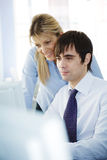 Collegues. Two office workers or students looking at computer monitor Royalty Free Stock Images