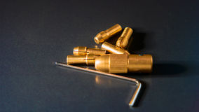 Collet chuck brass Collet Fits. Adapter on black background Stock Image