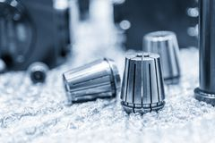The collet  spare parts on the floor. The CNC part ,collet spare parts on the floor Stock Photo