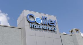 Collier Insurance Sign. A sign on a Collier Insurance business building royalty free stock images