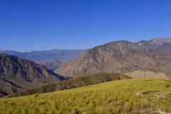 Colline e montagne, Kadamzhai, Kirghizistan Immagine Stock Libera da Diritti