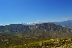 Colline e montagne, Kadamzhai, Kirghizistan Fotografia Stock Libera da Diritti