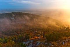 Colline in nuvole Fotografia Stock