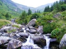 Colline verdi delle montagne Fotografia Stock