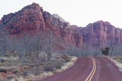 Colline Zion National Park Desert dell'alta montagna di alba della strada Fotografie Stock