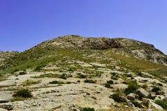 Collines et montagnes, Kadamzhai, Kirghizistan Photos stock