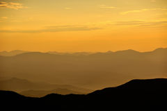 Collines sur le lever de soleil Photographie stock libre de droits