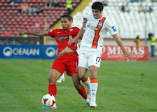 Collins Fai and Anton Shynder in Dinamo Bucharest-Shaktar Donetk Royalty Free Stock Photos