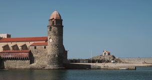 Collioure, France. Church Of Our Lady Of The Angels Across Bay In Sunny Day. Collioure, France. Church Of Our Lady Of The Angels Across Bay In Sunny Spring Day stock video