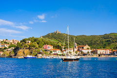 COLLIOURE, FRANCE - JULY 5, 2016: Yacht, beach and hotels in Collioure, Roussillon, Vermilion coast, Pyrenees Orientales, France Royalty Free Stock Photo