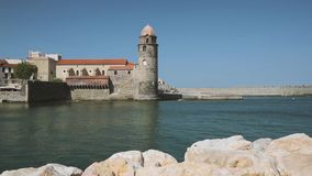 Collioure, France. Pan View Of Church Of Our Lady Of The Angels Across Bay In Sunny Spring Day.  stock video
