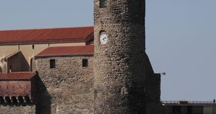 Collioure, France. Tilt View Of Church Of Our Lady Of The Angels Across Bay In Sunny Spring Day.  stock video