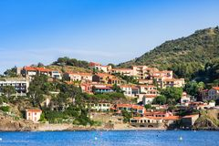 Collioure village with castlel at top of hill, Roussillon, Vermilion coast, Pyrenees Orientales, France Royalty Free Stock Images