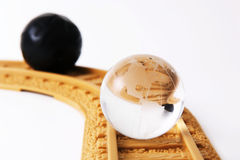Collision Course. Glass globe on a collision course with a white background Royalty Free Stock Images